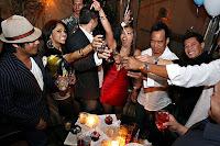 People raising their drinks in a nightclub