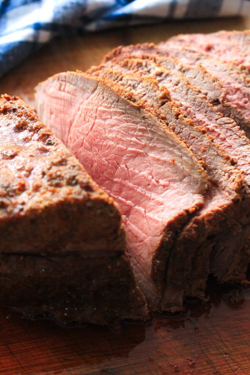 This herb-rubbed Sirloin Tip Roast is a frugal cut of beef that yields deliciously tender, flavorful, juicy meat. You won't believe how easy it is to make! #sirloin #dinner #beefrecipe