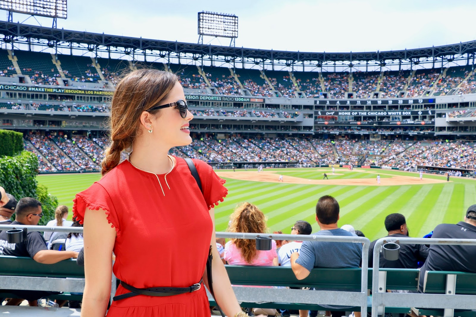 Fashion blogger Kathleen Harper wearing baseball game fashion