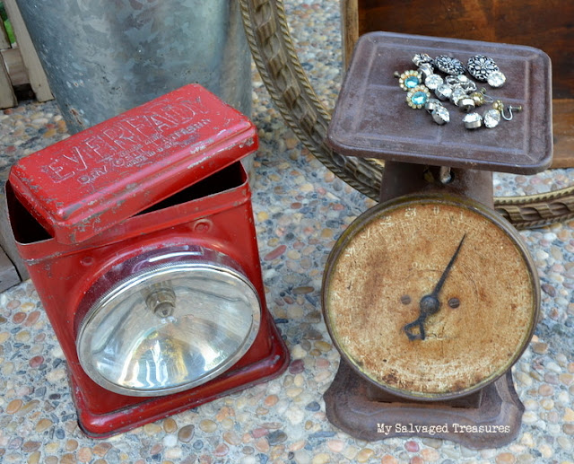 rusty old scale and Eveready flashlight lantern