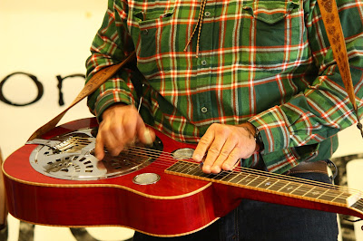 Red Resonator, plaid shirt