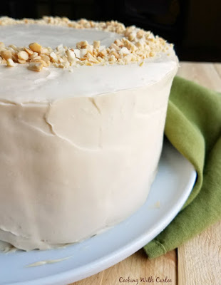 silky smooth side of round applesauce cake coated with caramel cream cheese frosting