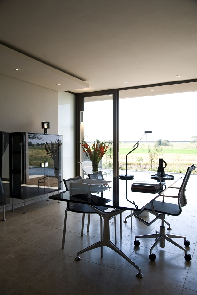 Glass table in modern home office
