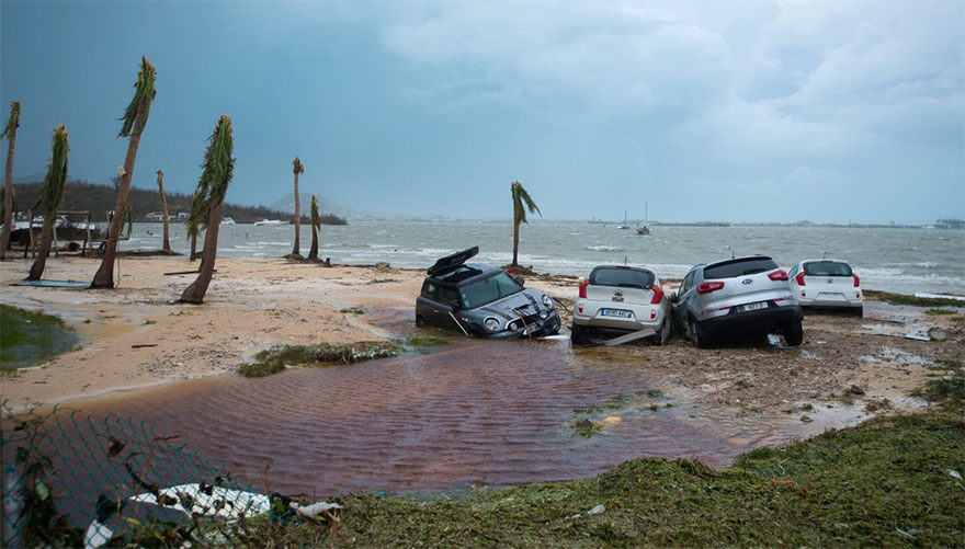 30 Shocking Pictures That Show How Catastrophic Hurricane Irma Is - Damaged Cars Are Seen On A St. Martin Beach
