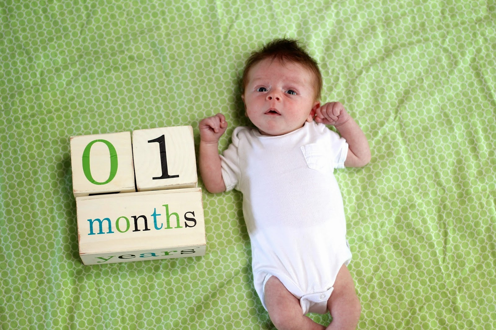 Well, now that we're a week and two days beyond your 1-month birthday, I'm  finally getting around to blogging about this big milestone!