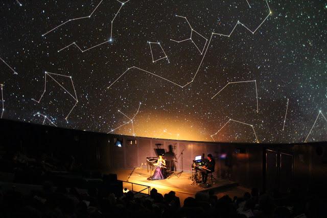 Ryuji Iuchi and Hiroko Suzuki perform beneath a canopy of stars