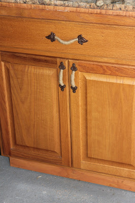 Eclectic Red Barn: Mismatched drawer pulls updated and on cabinet