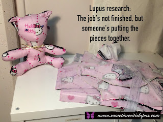 Image: an incomplete sewing project.  Text: Lupus research: the Job's not finished, but someone's putting the pieces together.