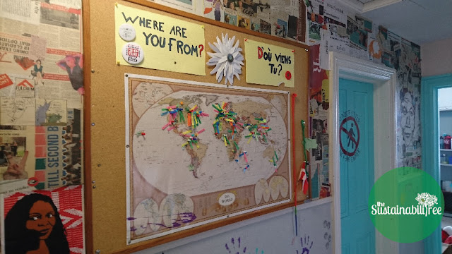 A map at the Free Store with pins indicating all the countries of the world that Free Store visitors have come from