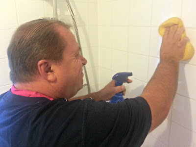 Man scrubbing bathroom tiles