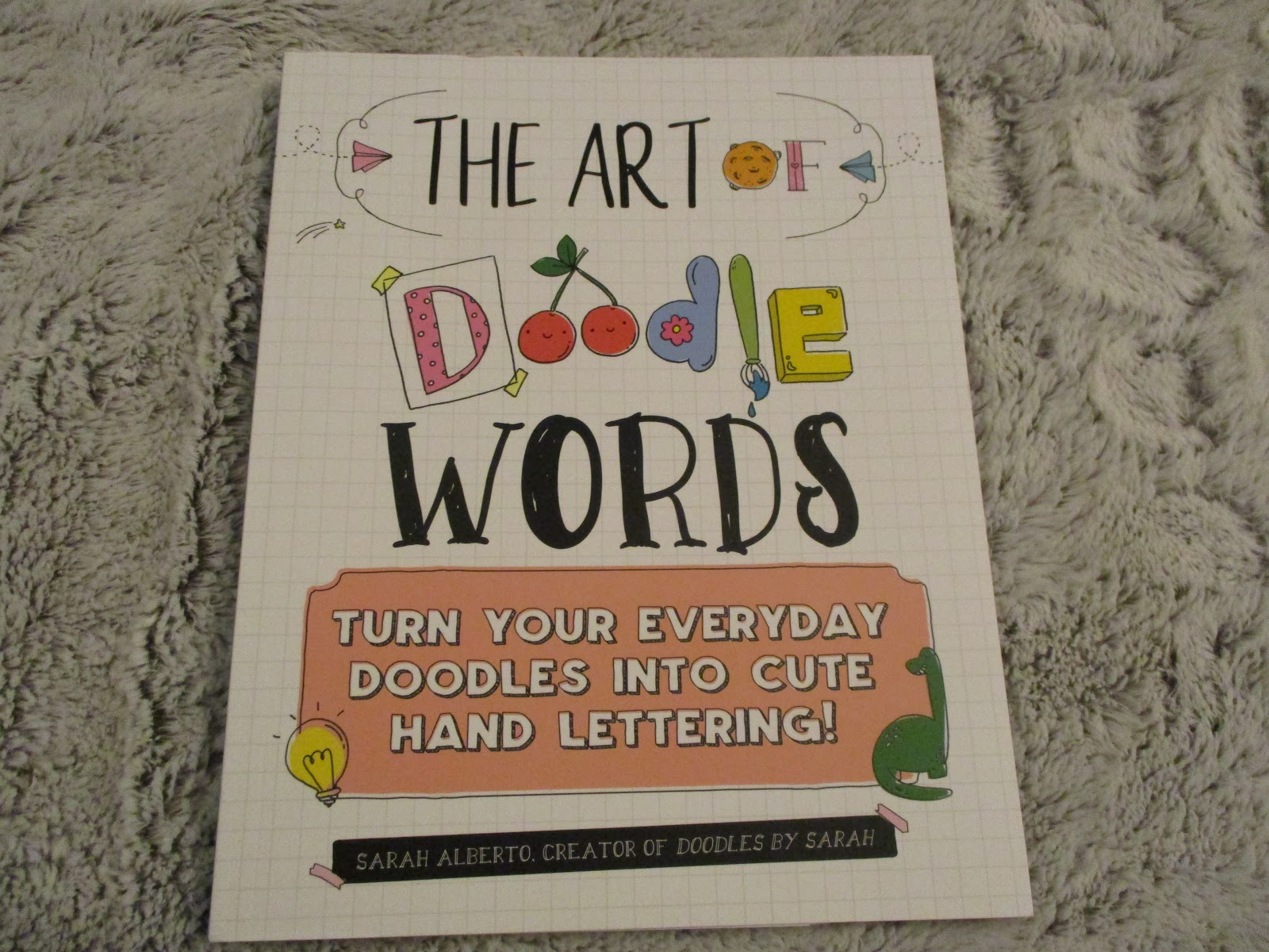 The Art of Doodle Words Turns Your Everyday Doodle into Cute Hand Lettering!  By Sarah Alberto and Illustrated by Sarah Alberto from Quarto Knows.