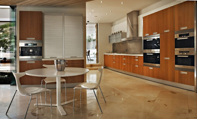 Photo of huge kitchen with small round dinning table