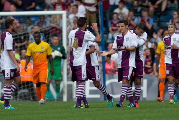Ashley Westwood celebrates his goal against Wycombe with Aston Villa teammates