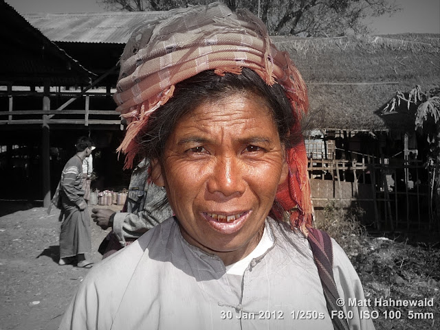 Burma; Myanmar; Inle Lake; Intha woman; Burmese woman; people; portrait; Burmese market woman; focal black and white; Facing the World; eye contact; smiling; headshot; Matt Hahnewald Photography; headshot; portrait; posing; 4 : 3 aspect ratio; Panasonic Lumix DMC-TZ5; photo; image; travel portrait; environmental portrait; culture; one person; real people; human; photography; consent; empathy; rapport; portraiture; travel destination; tourism; horizontal format; world cultures; human face; human eyes; closeup; street; post-processing; editing; experiment; Photoshop; Picasa; focal B&W; experimental; amazing; interesting; inspirational; educational; facial expression