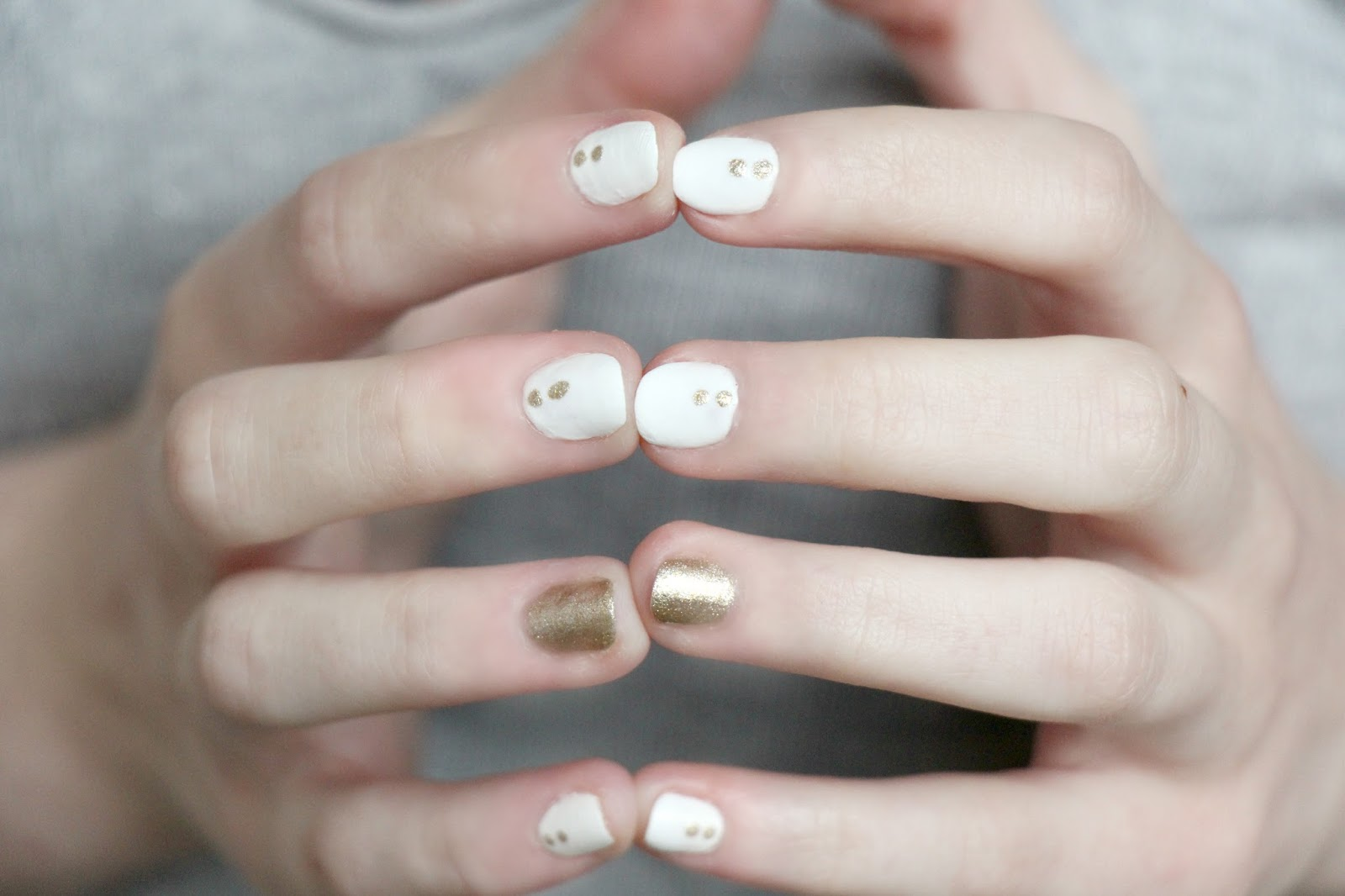 gold and white nail art