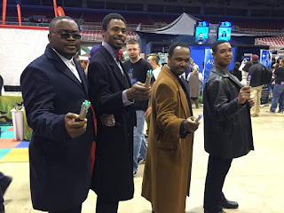 Photo of cosplayers dressed as the 9th, 10th, 11th, and 12th Doctors.