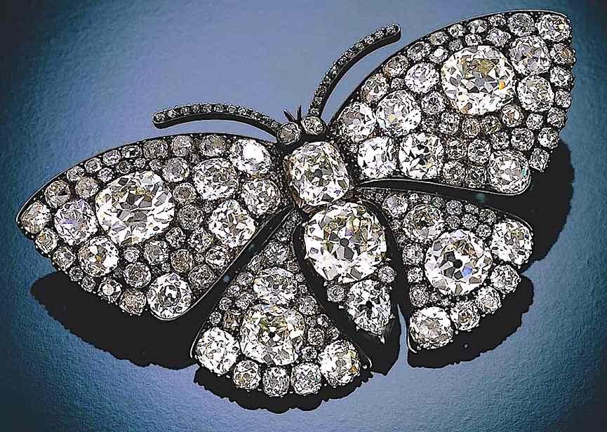 a Lalique diamond butterfly broach, a color photograph close up