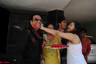 Govinda celeting Holi with His family wife daughter 010.JPG