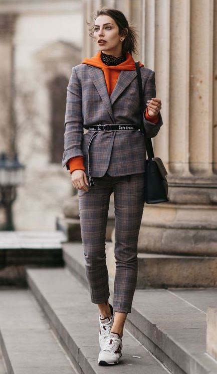 office outfit idea to copy this fall / plaid suit + sneakers + belt + orange hoodie