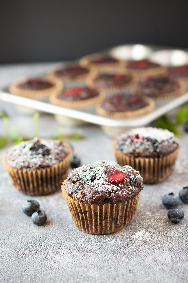 Double Chocolate Berry Muffins (Vegan) dusted with powdered sugar