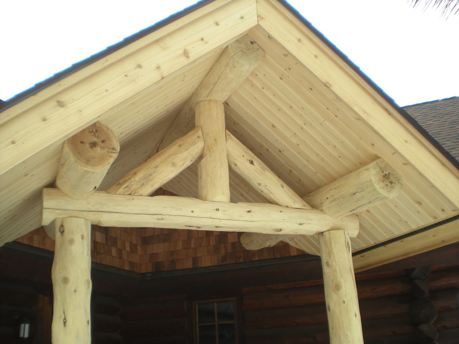 Log Posts And Truss Covered Entry Project Huisman Concepts