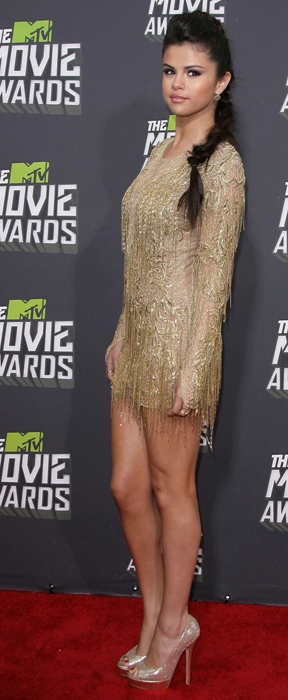 0a5b1f933c9a Selena Gomez wore Jimmy Choo Vibe shoes peep-toe platform pumps at the MTV  Movie Awards 2013. This shoe features 6