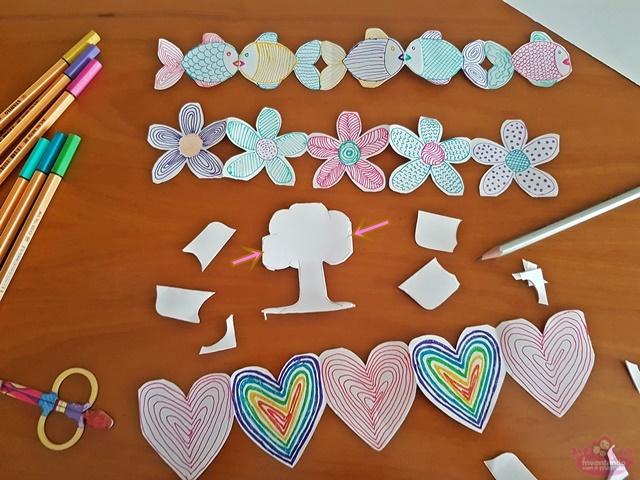 Brincadeira com papel e tesoura