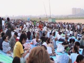 Japanese customers enjoying fireworks copyright peter hanami 2012
