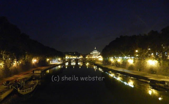 We look down the river to see the lights of the walks and St. Peter's Basilica