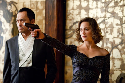 Marion Cotillard as Mal and Ken Watanabe as Saitu in Christopher Nolan's Inception