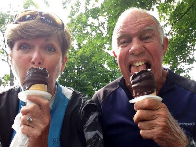 man and woman eating chocolate covered ice cream