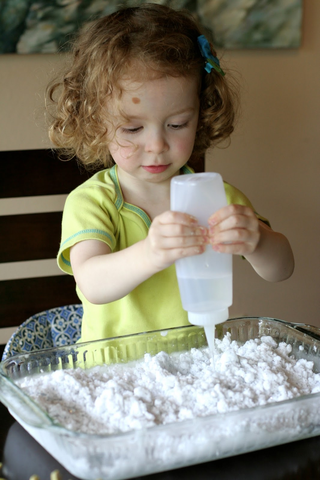 Frozen Sensory Snow - Easy, cheap (cost around one dollar!), and the icy cold lasted for TWO hours while we played!  Perfect for keeping cool this summer from Fun at Home with Kids