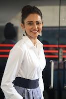 Rakul Preet Singh looks super cute in White Shirt and Skirt at Jaya Janaki Nayaka press meet 10.08.2017 016.JPG