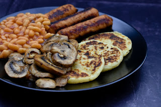 Vegan cooked breakfast with mushrooms, tattie scones, veggie sausages and baked beans