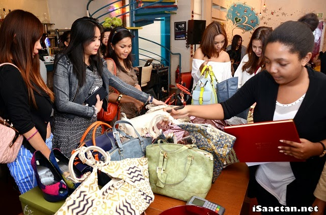 The guests taking the opportunity to snap up Tsar creations at a special price that day