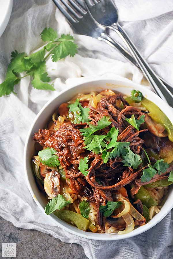 Serve up a deliciously satisfying dinner easily with this Beef Bowl Recipe. Leftover BBQ slow cooker brisket and fresh sauteed vegetables are served a top a bowl of rice and makes an easy dinner recipe everyone will love! #LTGrecipes
