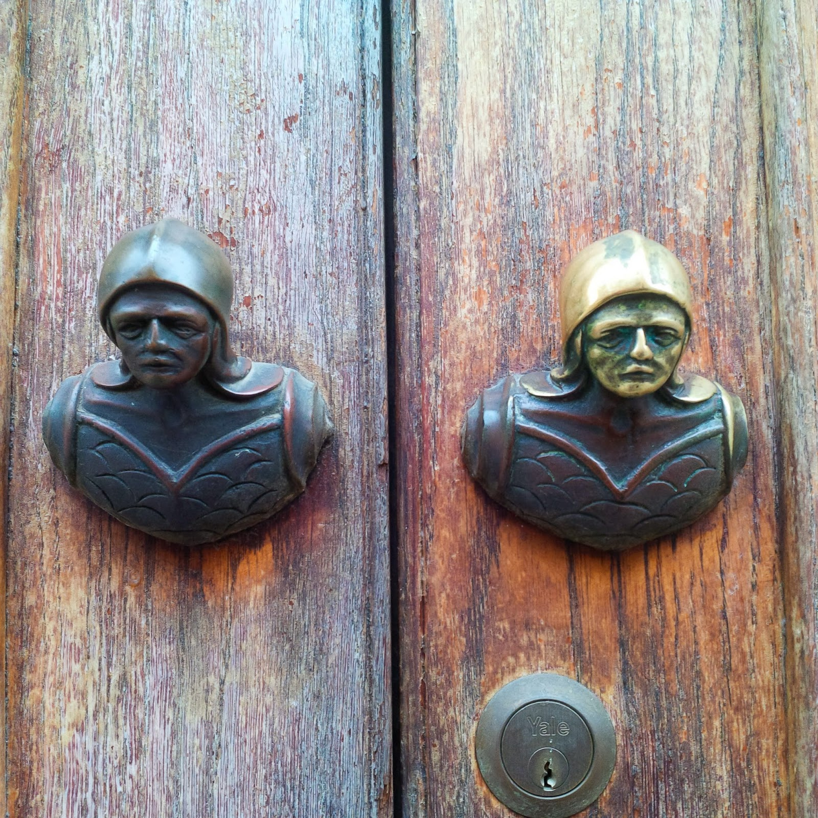 Soldiers' heads door handles as seen in Vicenza, Italy