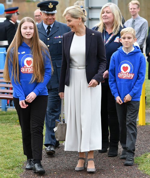 The Countess of Wessex wore Max Mara belted stretch-cady midi dress. Countess Sophie wore a white cady dress by MaxMara