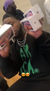 Davido buys new iPhones for his gang