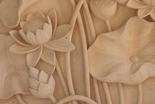 White sandstone carved lotus flowers decorate interior and exterior walls very beautiful
