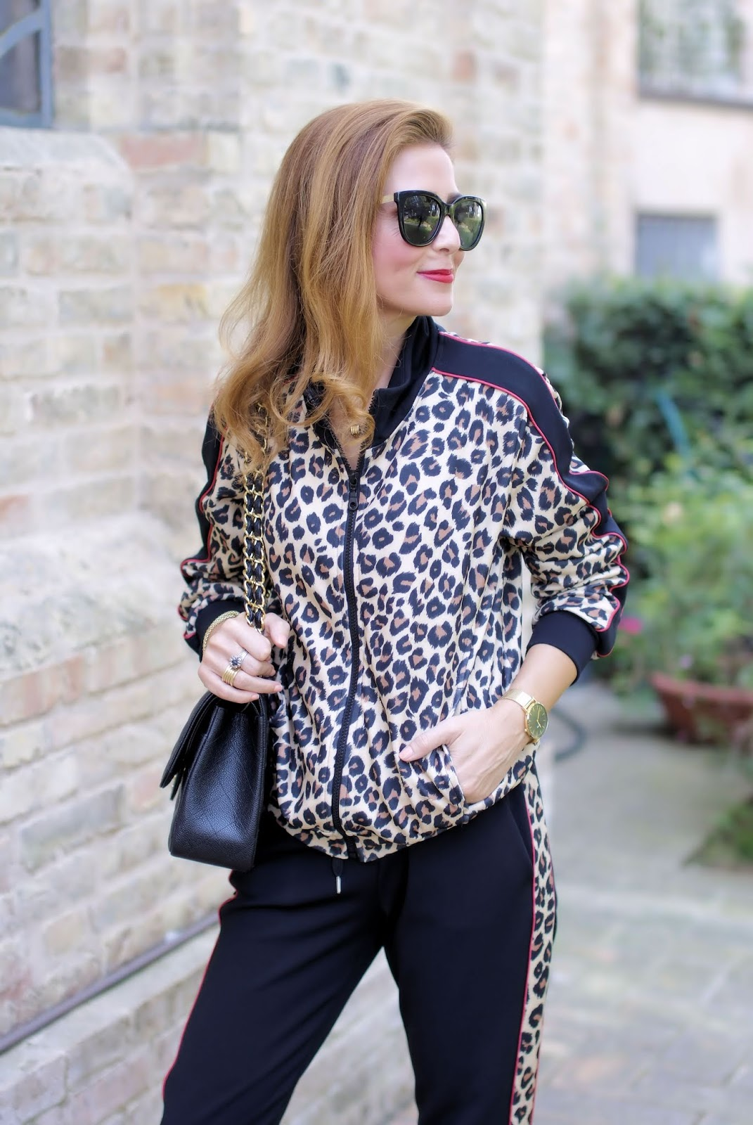The animal print trend: leopard print tracksuit on Fashion and Cookies fashion blog, fashion blogger style