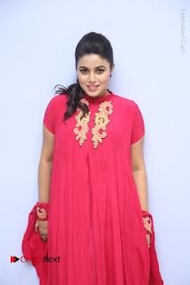 Actress Poorna Latest Stills in Red Dress at Rakshasi First Look Launch  0104.JPG