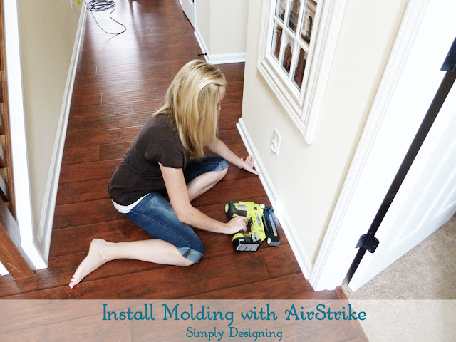 Install Molding using a Ryobi AirStrike | #diy #molding #laminateflooring #flooring #homeimprovement | at Simply Designing