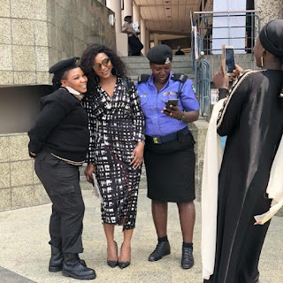 Genevieve All Glammed Up In A Photo With Uniformed Ladies