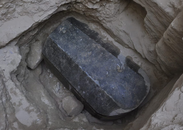 Archaeologists in Egypt open large black granite sarcophagus found in Alexandria