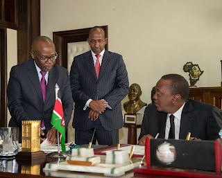 President Kenyatta signs the ant-torture law. PHOTO | Courtesy PSCU