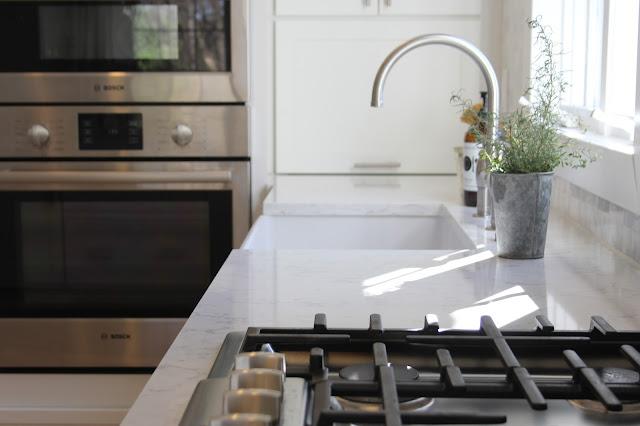 Minimal modern farmhouse white Shaker kitchen by Hello Lovely Studio