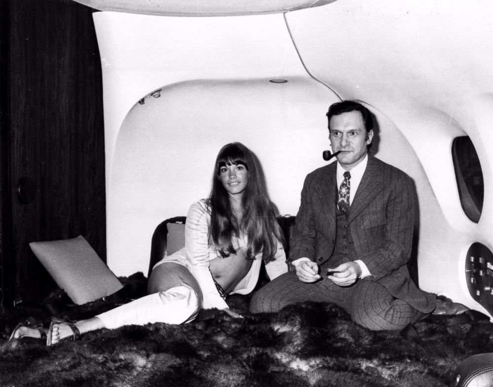 The president of playboy enterprises hugh hefner with girlfriend barbi benton in his luxury dc 9 aircraft the big bunny at heathrow
