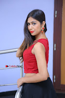 Telugu Actress Nishi Ganda Stills in Red Blouse and Black Skirt at Tik Tak Telugu Movie Audio Launch .COM 0265.JPG