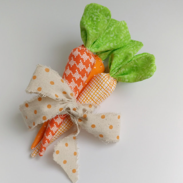 Sewing Tutorials: How to Make Fabric Carrots, a tutorial featured by top US sewing blog, Ameroonie Designs: Tie your fabric carrots into a bunch with a bright ribbon to create a fun accent piece